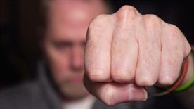 Man with his fist raised - Violent crimes defense in Atlanta, GA